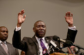 The family attorney for Michael Brown Benjamin Crump raises his hands and speaks during a press conference where Michael Baden a medical examiner who...