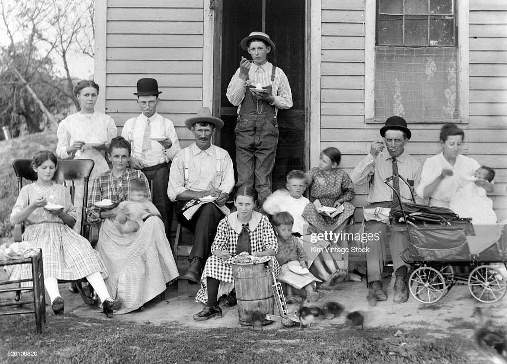 The family gathers outside to eat dessert, ca. 1910