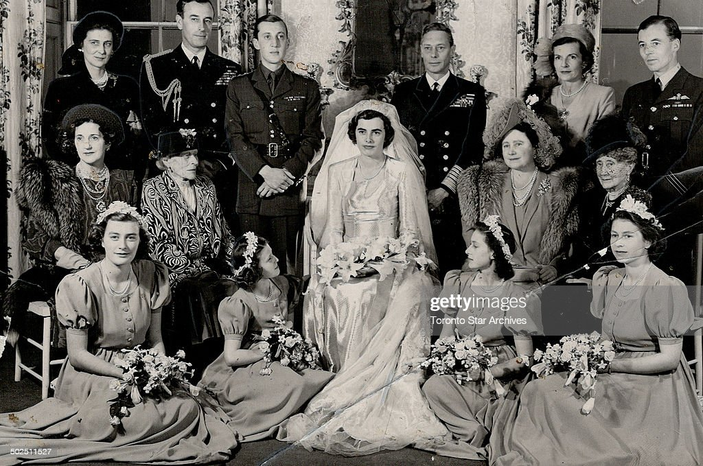 The family group was taken at Lady Patricia Mountbatten's wedding. Included are Duchess of Kent; Earl Mountbatten; the bride groom; Lord Brabourne; the King; Countess Mountbatten; C. Harris St. John; best man; the Queen; the bride and the four bridesmaids
