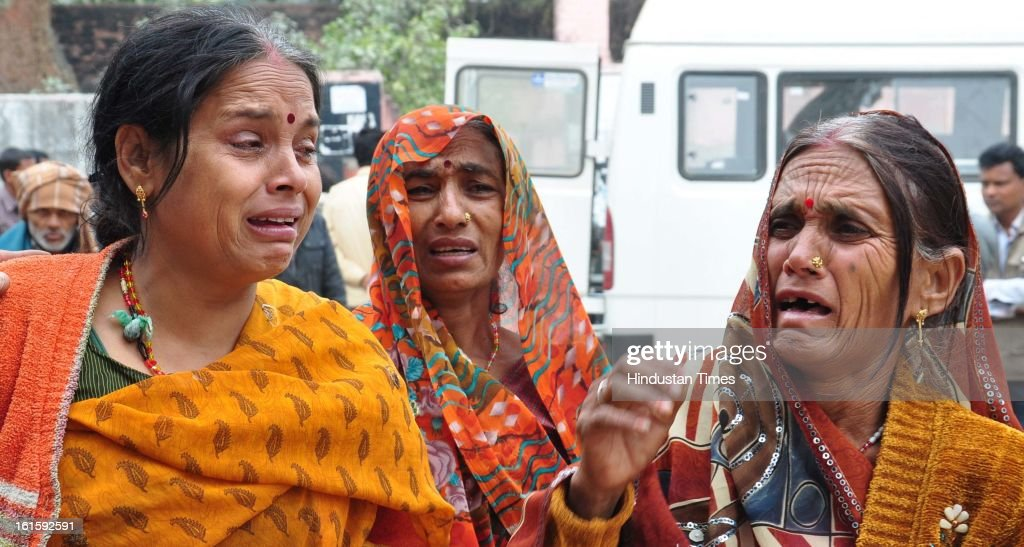 The family members of the deceased and victim of stampede weeping outside the postmortem house at Swarooprani Nehru Hospital on February 12, 2013 in Allahabad, India. 37 people have died so far in stampede at Allahabad Railway station on February 10, 2013. UP CM Akhilesh Yadav visited the Swaroop Rani Nehru Hospital here, where more than 30 people injured in the February 10 stampede are undergoing treatment.