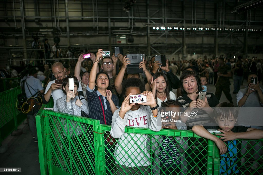 The family members of the U.S. and Japanese servicemen try to get a glimpse of The U.S. President Obama as he landed in the Marine Corps Air Station Iwakuni (MCAS Iwakuni) on May 27, 2016 in Iwakuni, Japan. President Obama flew in to the MCAS Iwakuni on Air Force One, and visited the troops before visiting Hiroshima.