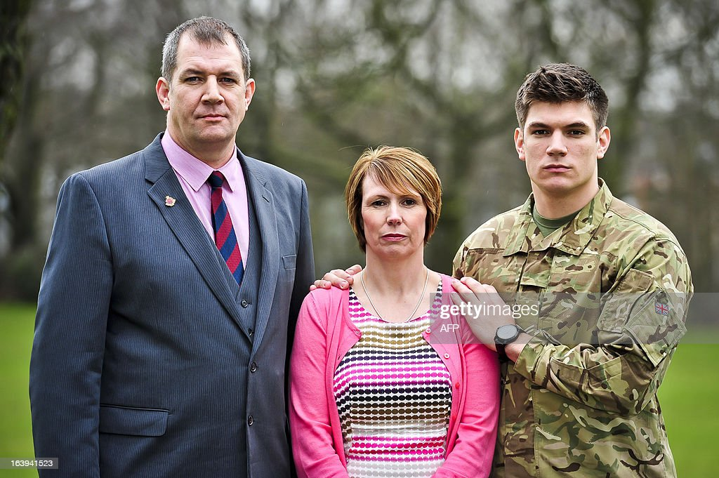 The family of British soldier Lance Corporal James Ashworth, mother Kerry Ashworth (C), father former Grenadeer Guardsman Duane Ashworth (L) and brother and British soldier Coran Ashworth (R) pose for a photograph at Buller Barracks, in Aldershot, Hampshire on March 18, 2013 as it is announced that Lance Corporal James Ashworth, who was killed in action in Afghanistan, is to be awarded the Victoria Cross in recognition of his 'extraordinary courage' while serving with the 1st Battalion The Grenadier Guards in Helmand province last year. James Ashworth is to be posthumously awarded Britain's most prestigious military honour, the Victoria Cross, only the 10th such medal since World War II, for leading a 'supremely courageous' assault against Taliban snipers, it was announced on March 18. AFP PHOTO / POOL / BEN BIRCHALL