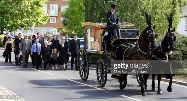 The family of Cpl John Johnston Cosby walk behind his coffin as they arrive at Belmont Chapel in Exeter for his funeral They included from left to...