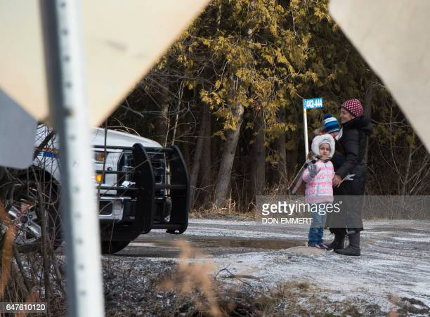 The family of Erkan Cüce from Turkey wave goodbye to family members who dropped them off at the US/Canada border February 26 in Champlain NY The...