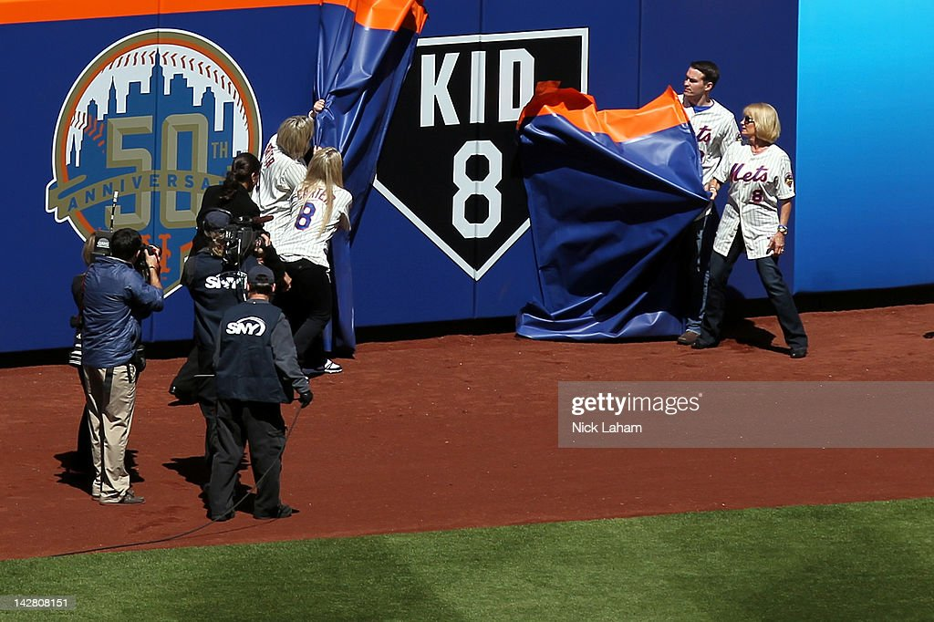 The Family of former New York Mets catcher and Hall of Famer Gary Carter, including his wife Sandy, son D.J. and daughters Kimmy and Christy, unveil a sign an the outfield wall which reads 'Kid 8' in honor of the late Gary Carter who passed away in the offsesson during their Opening Day Game against the Atlanta Braves at Citi Field on April 5, 2012 in New York City.