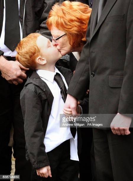 The family of former X Factor finalist Kerry McGregor including her son Joshua being kissed by Kerry's mother Margaret as they follow her coffin...