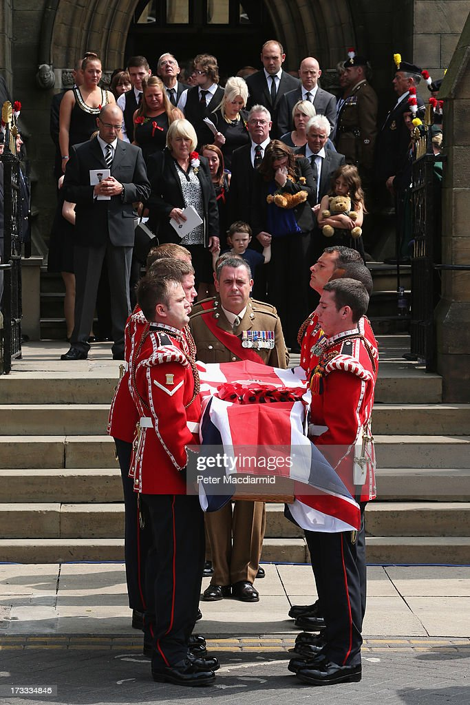 The family of Fusilier Lee Rigby follow his coffin as it leaves Bury Parish Church after his military funeral on July 12 2013 in Bury Greater...