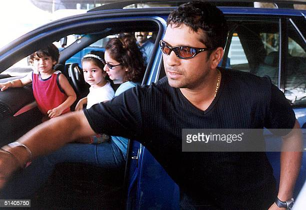 The family of India's star batsman Sachin Tendulkar waits for him in the car upon his arrival at the Bombay airport 01 October 2002 The Indian...