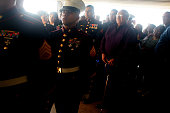 The family of Joshua Ware a United States Marine killed in action in Fallujah Iraq follow his casket into the Commanchee Communitty Center during his...