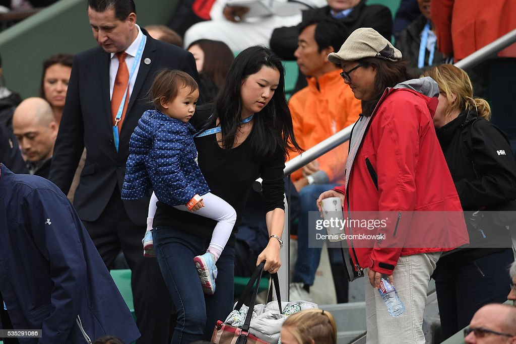 The family of Kei Nishikori of Japan attend his Mens Singles fourth round match against Richard Gasquet of France on day eight of the 2016 French Open at Roland Garros on May 29, 2016 in Paris, France.