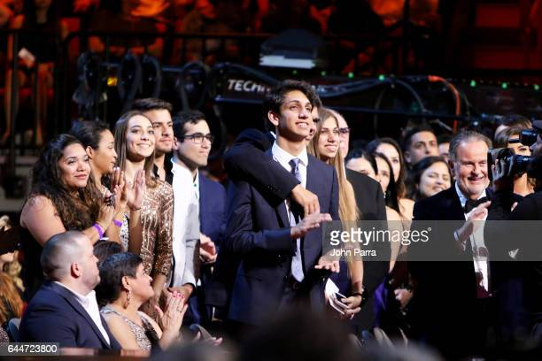 The family of Lili Estefan watches her receive an award onstage Univision's 29th Edition of Premio Lo Nuestro A La Musica Latina at the American...