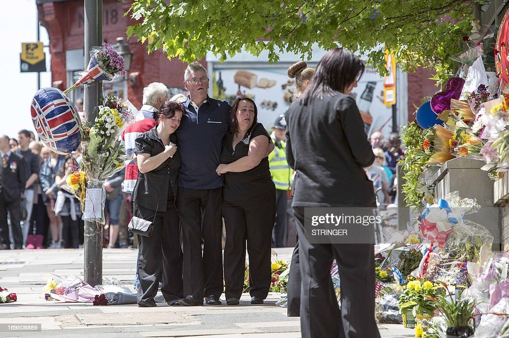 The family of murdered British soldier Drummer Lee Rigby; (L-R) his sister Sara McClure and his stepfather and mother Ian and Lyn Rigby arrive at the site of his death in Woolwich, east London on May 26, 2013. Drummer Lee Rigby, 25, who survived a tour of duty in Afghanistan, was butchered in broad daylight outside the Royal Artillery Barracks in Woolwich, southeast London. AFP PHOTO/STRINGER