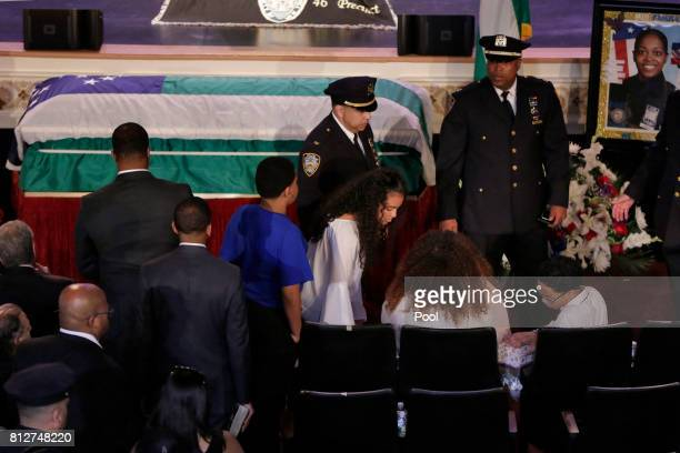 The family of New York City Police Officer Miosotis Familia arrives for her funeral at the World Changers Church July 11 2017 in The Bronx borough of...