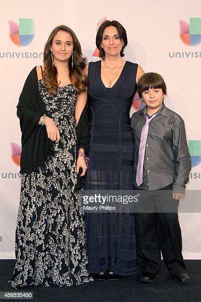 The family of Paco de Lucia winner of Best Flamenco Album pose in the press room during the 15th annual Latin GRAMMY Awards at the MGM Grand Garden...