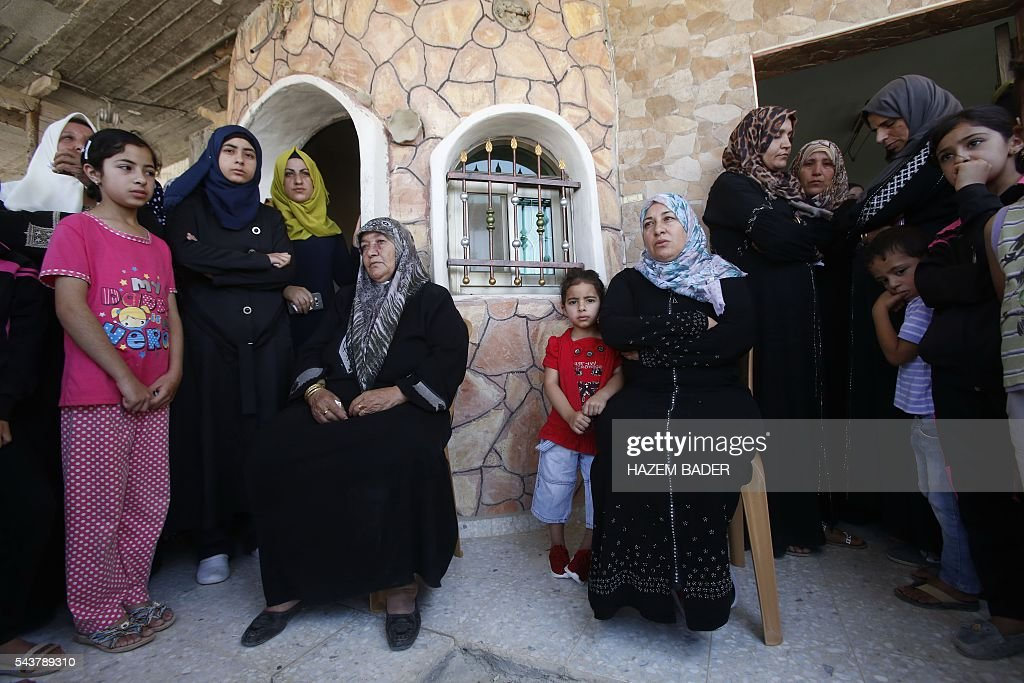 The family of Palestinian Mohammed Nasser Tarayra, who stabbed to death an Israeli teen in a Jewish settlement in the occupied West Bank on June 30,2016 is seen outside their family home in the village of Bani Naim, near the Palestinian city of Hebron. A Palestinian attacker fatally stabbed a 13-year-old girl in her home in a Jewish settlement in the West Bank before being shot dead by security guards, the Israeli army said. BADER