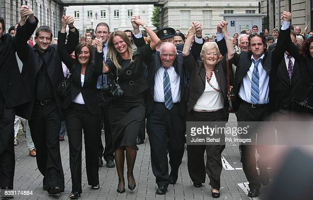 The family of Rachel O'Reilly cheer after leaving the Central Criminal Court Dublin