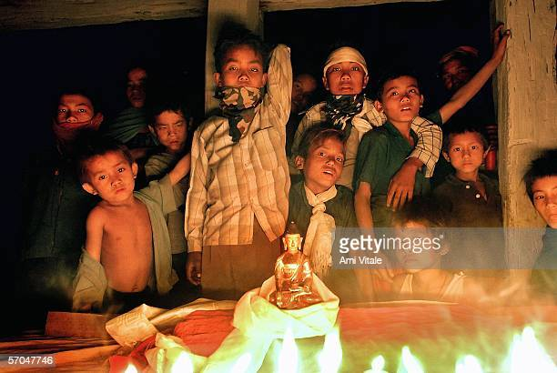 The family of Ram Bahadur Bamjan who is being called the Buddha reincarnate celebrates a family marriage with an altar and a statue of Buddha in...