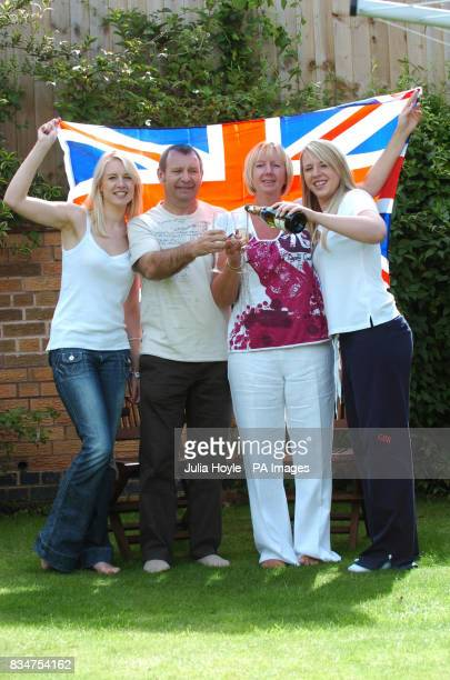 The family of Rebecca Adlington parents Steve and Kay and sisters Chloe and Laura celebrate at their home in Mansfield Notts after she took gold at...