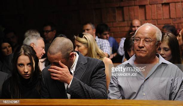 The family of South African Olympic sprinter Oscar Pistorius his brother Carl his father Henke and his sister Aimee are pictured on February 21 2013...
