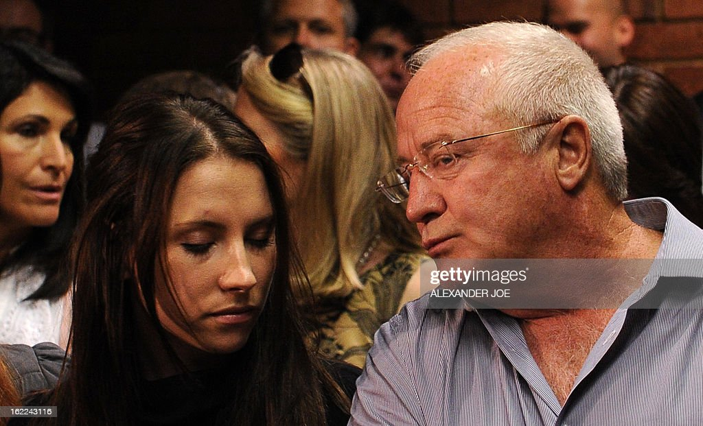 The family of South African Olympic sprinter Oscar Pistorius his father Henke and his sister Aimee are pictured on February 21 2013 at the Magistrate...