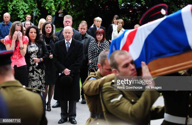 The family of the killed British soldier Sapper Jordan Rossi sister Lynsay Fallon mother Theresa Rossi and sister Kelly Fallon follow his coffin...