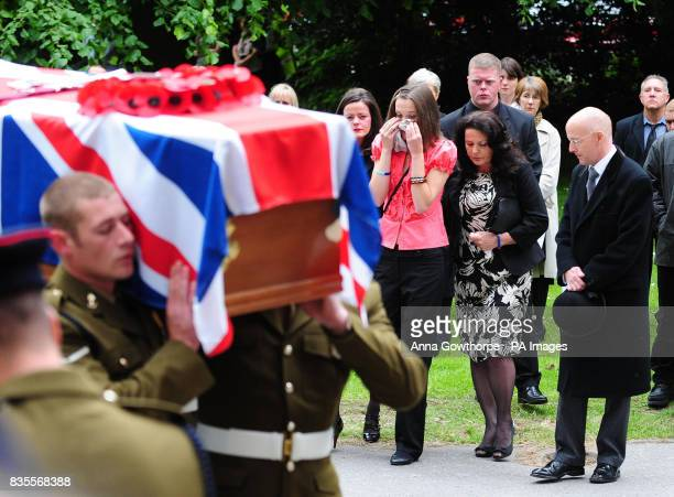 The family of the killed British soldier Sapper Jordan Rossi sister Kelly Fallon sister Lynsay Fallon and mother Theresa Rossi follow his coffin...