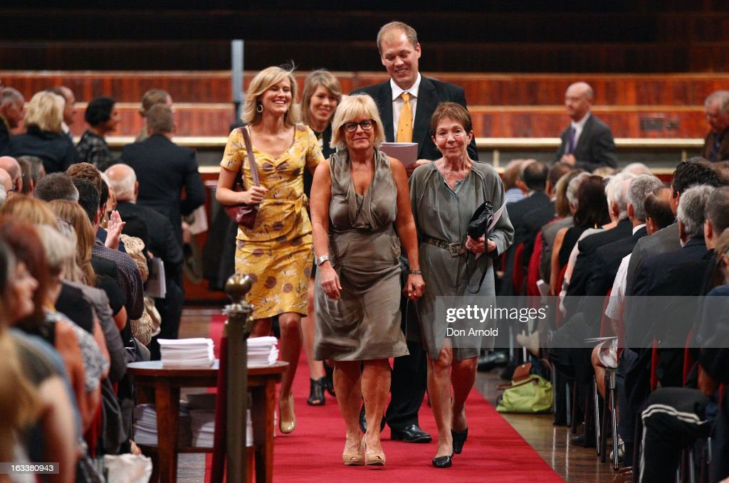 The family of the late Peter Harvey,including wife Anne Harvey (front right) and children Claire Harvey (back centre) and son Adam Harvey (back right) leave the public memorial service held for him at Sydney Town Hall on March 9, 2013 in Sydney, Australia. Television journalist Peter Harvey, died in Sydney on March 2 aged 68 after a battle with pancreatic cancer.