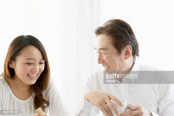 The family who has a pleasant chat at a dining table