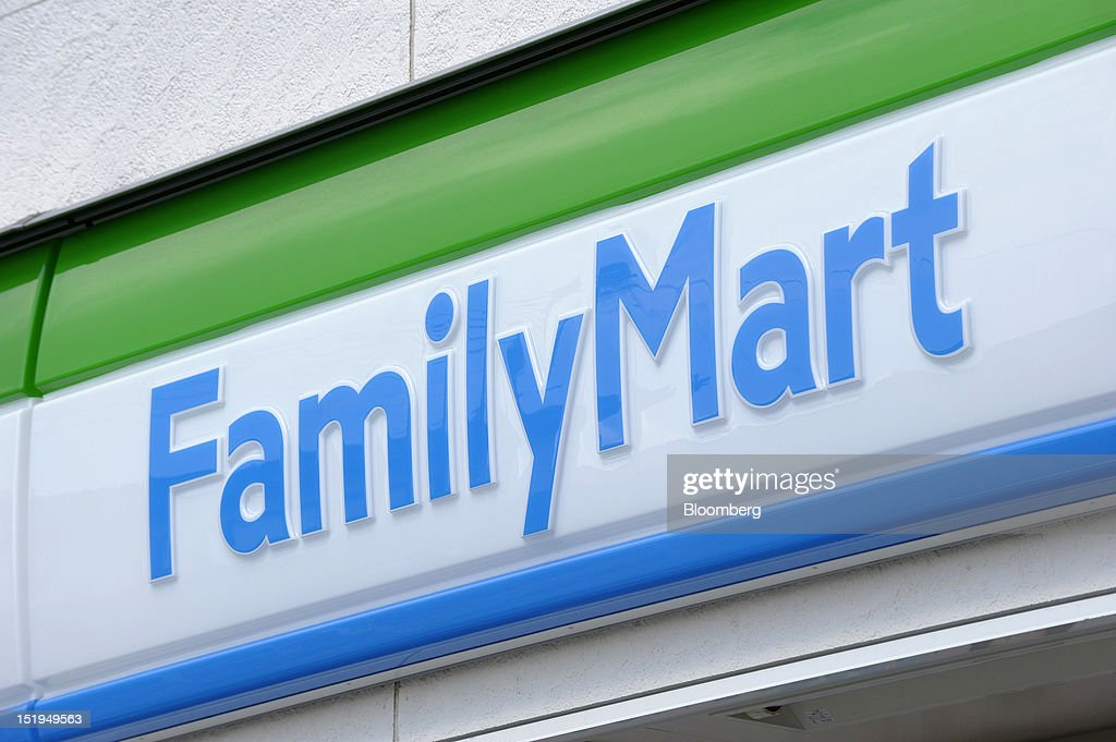 The FamilyMart Co. logo is displayed outside the company's convenience store in Yokohama City, Kanagawa Prefecture, Japan, on Tuesday, Sept. 11, 2012. Sales at Japan's convenience stores declined 3.3 percent in July from a year ago on a same-store basis, according to the Japan Franchise Association. Photographer: Akio Kon/Bloomberg via Getty Images