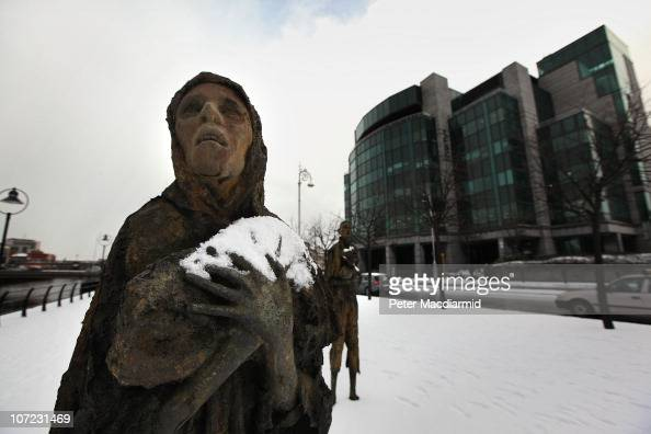 The Famine memorial sculpture stands covered in snow outside The International Financial Services Centre on December 1 2010 in Dublin Ireland The...