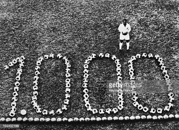 PELE the famous Brazilian football player celebrating his 1000th goal in front of the triumphant number formed by footballs