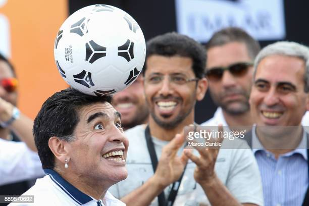 The famous football player Diego Armando Maradona plays with a ball during a meeting with the fans in Naples