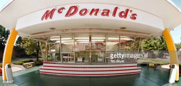 The famous golden arches and red and white tiles of McDonald's frame the two walkup windows at the McDonald's museum July 14 2000 in Des Plaines IL...