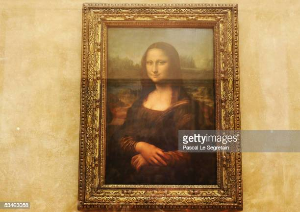 The famous Leonardo Da Vinci painting ' The Mona Lisa' is seen on display in the Grande Galerie of the Louvre museum on August 24 2005 in Paris...