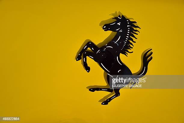 The famous logo of car maker Ferrari representing a prancing horse is pictured at the Ferrari Museum on October 18 2015 in Maranello Fiat Chrysler...