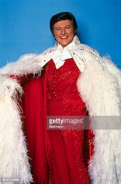 The famous piano impresario who possesses two Emmy awards Liberace smiles in this red sequined outfit