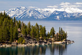 The famous property of the Thunderbird Lodge is framed by Lake Tahoe and the snow-capped peaks of the Sierra Nevada, NV.