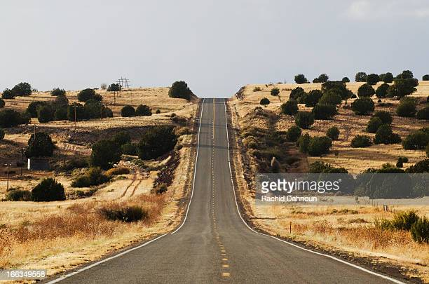 The famous road, Route 66, stretches across the Arizona desert near Seligman, NM.