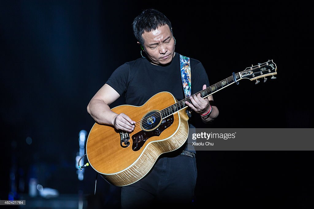 The famous singer Xu Wei performs at 2014 Zhangbei Grassland Music Festival on July 19, 2014 in Beijing, China. Zhangbei Grassland Music Festival which located at Hebei Province is one the top music festival in China, the festival takes 'Go Wild' as its slogan and blends natural grassland ecology and a low-carbon lifestyle.