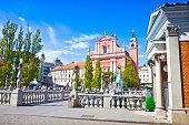 The famous 'Triple Bridge' on Ljubljanica river (Ljubljana city center - Slovenia - Europe) - People are not recognizable.