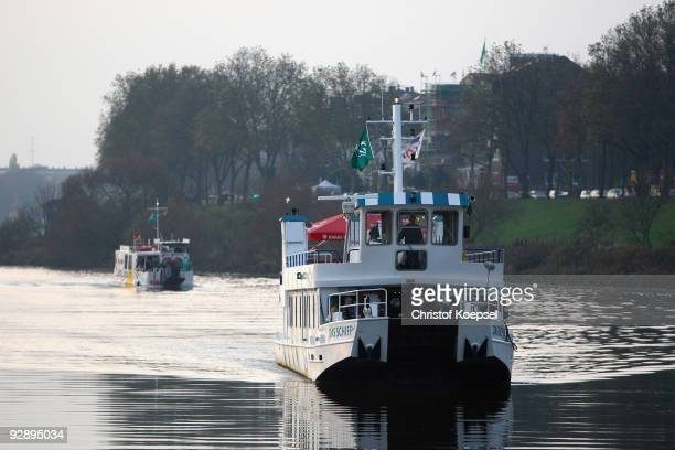The fan ship of Werder Bremen carries the fans over the Weser to the new pier before the Bundesliga match between SV Werder Bremen and Borussia...