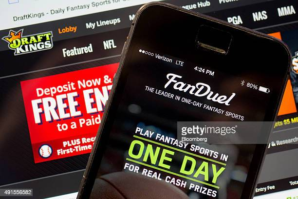 The FanDuel Inc app and DraftKings Inc website are arranged for a photograph in Washington DC US on Monday Oct 5 2015 Fantasy sports companies...