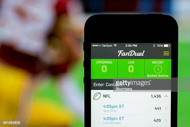 The FanDuel Inc app is arranged for a photograph on an Apple Inc iPhone in Washington DC US on Sunday Oct 4 2015 Fantasy sports companies DraftKings...