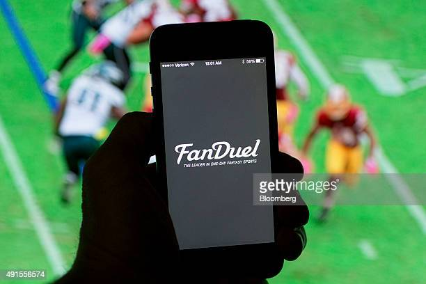 The FanDuel Inc logo is arranged for a photograph on an Apple Inc iPhone in Washington DC US on Sunday Oct 4 2015 Fantasy sports companies DraftKings...