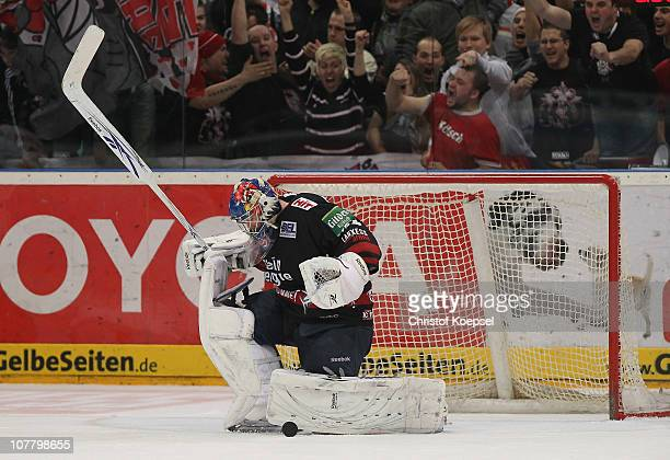 The fans celebrate the 32 victotry after penalty shootout afterr Danny aus den Birken of Koelner Haie saves a penalty during the DEL match between...
