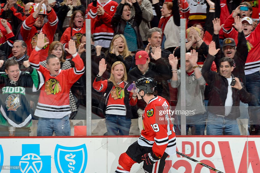 The fans go wild after <a gi-track='captionPersonalityLinkClicked' href=/galleries/search?phrase=Jonathan+Toews&family=editorial&specificpeople=537799 ng-click='$event.stopPropagation()'>Jonathan Toews</a> #19 of the Chicago Blackhawks was successful on his shoot-out attempt against the Nashville Predators during the NHL game on April 01, 2013 at the United Center in Chicago, Illinois.