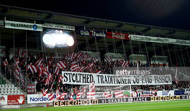 The fans of AaB Aalborg cheer with a tifo prior to the Danish Alka Superliga match between Viborg FF and AaB Aalborg at Energi Viborg Arena on...