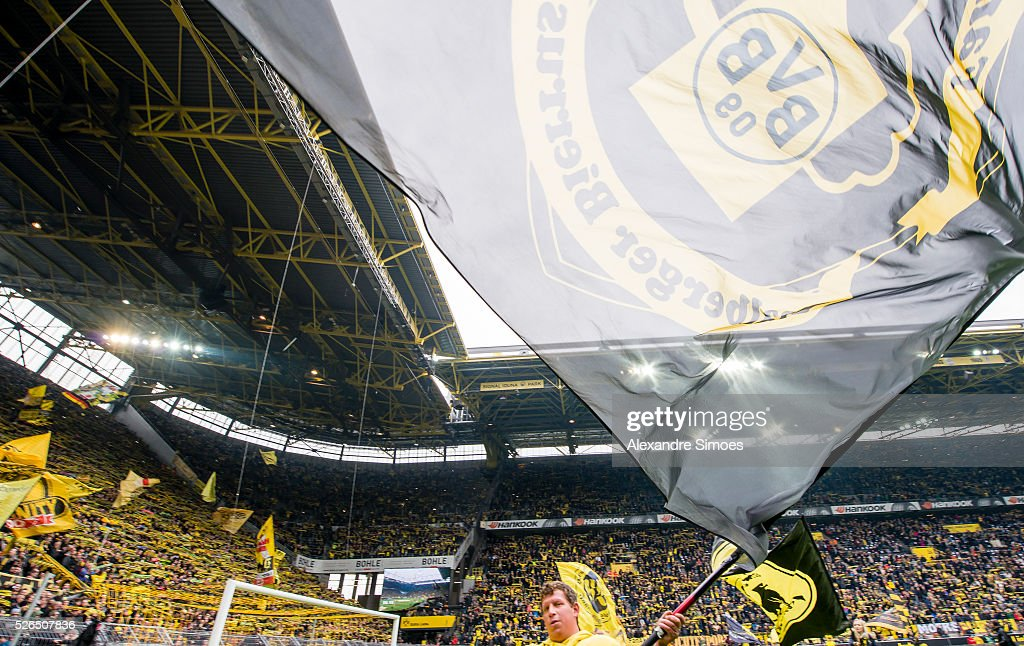 The fans of Borussia Dortmund in action prior to the Bundesliga match between Borussia Dortmund and VfL Wolfsburg at Signal Iduna Park on April 30, 2016 in Dortmund, Germany.