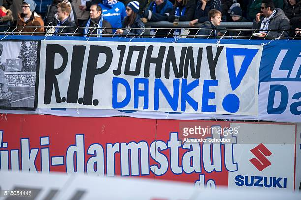 The Fans of Darmstadt 98 show banner in memory of Johnny a fan of Darmstadt 98 who died on wednesday during the first bundesliga match between SV...