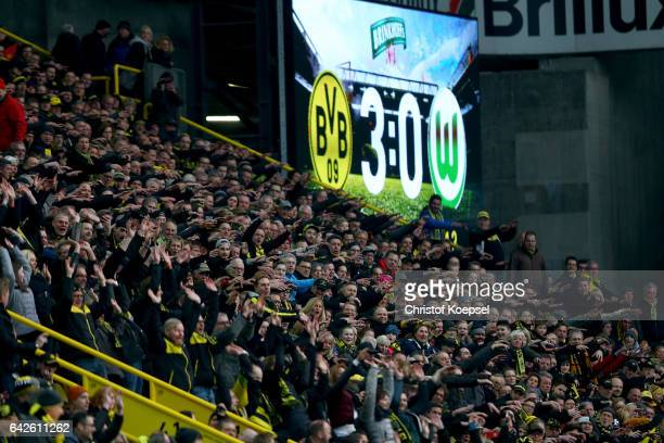 The fans of Dortmund celebrate during the Bundesliga match between Borussia Dortmund and VfL Wolfsburg at Signal Iduna Park on February 18 2017 in...